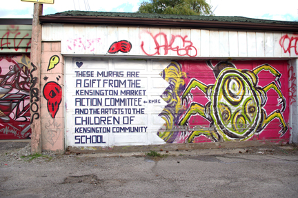 Laneway mural with dedication to KMAC, who funded the project